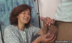 Sewing granny takes load of shit
