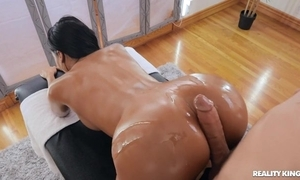 Tanned brunette beside fake boobs gangbanged by her masseur